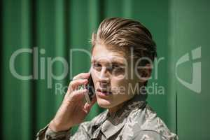 Portrait of military soldier talking on mobile phone