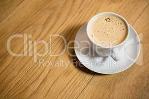 Coffee served on wooden table at cafe
