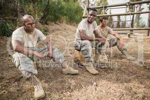 Military soldiers relaxing during obstacle training