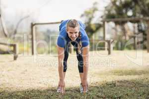 Fit woman exercising in boot camp on a sunny day