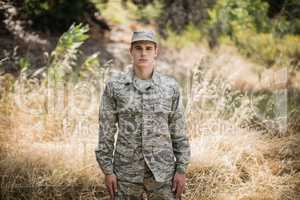 Portrait of military soldier standing in grass
