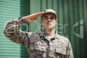 Close-up of military soldier giving salute