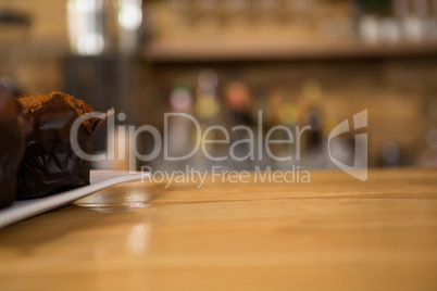 Muffin on wooden counter in coffee shop