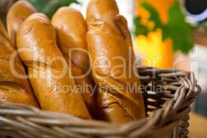 Fresh baked bread loaves in wicker basket