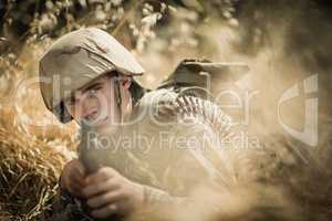 Portrait of military soldier aiming with a rifle