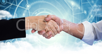 Composite image of business partners shaking hands