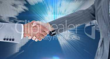 Composite image of male and female entrepreneurs shaking hands