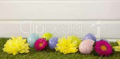 Multicolored Easter egg on grass