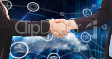 Composite image of businessman shaking hands with colleague