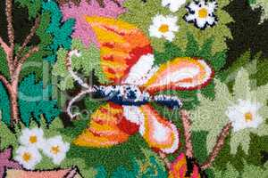 Needlework, a fragment of woven panels depicting butterflies.
