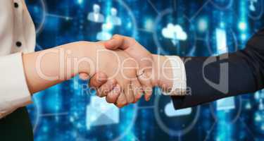 Composite image of corporate partners shaking hands