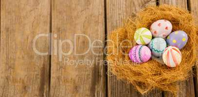 Painted Easter eggs in nest
