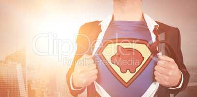 Midsection of businessman opening shirt in superhero style