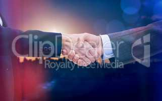 Composite image of entrepreneurs shaking hands