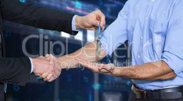 Composite image of businessman shaking hands and giving keys