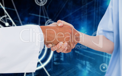 Composite image of medical practitioner shaking hands with patient