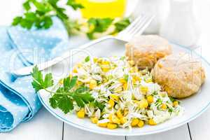 Vegetable cabbage salad and meatballs on plate close up, white background