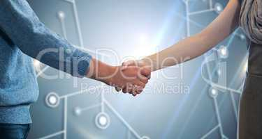 Composite image of partners shaking hands