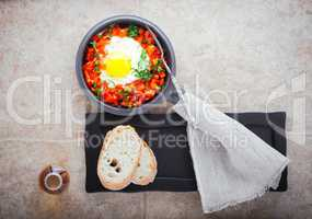 Traditional middle eastern dish of shakshuka in a pan .