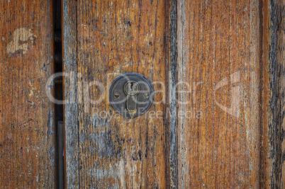 Lock on a brown shabby door,