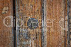 Lock on a brown shabby door,