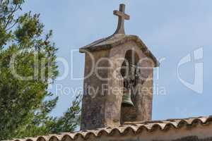 Church tower with bell in Spanish style