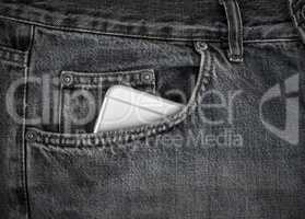 Smartphone in the front pocket of black jeans