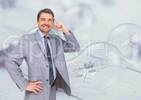 Businessman with idea against lightbulbs
