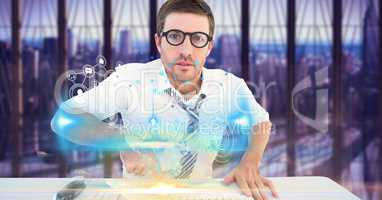 Digital composite image of businessman touching futuristic desk with icons on screen