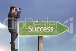 Side view of businessman using binoculars while standing on ladder by succees text on sign board aga