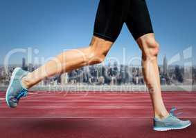 Runner legs on track against skyline