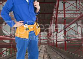 Builder with tools belt in 3D scaffolding