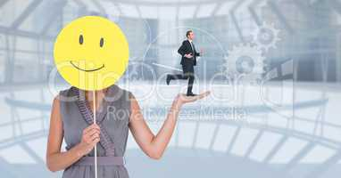 Digital composite image of businesswoman holding smiley while businessman running on her hand