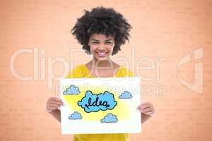 Portrait of smiling woman holding drawing of clouds representing ideas