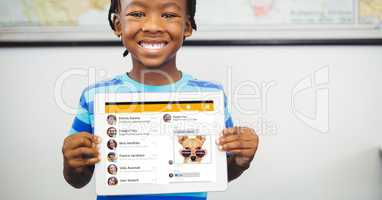 Happy boy showing tablet PC with social site displayed on screen