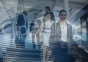 Business people walking down stairs with map graphic overlay