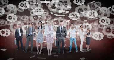 Digitally generated image of business people standing with gears flying in background