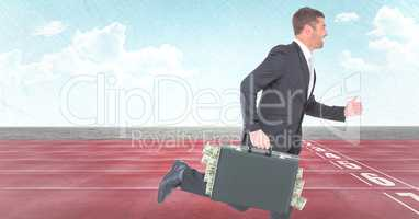 Business man with money sticking out of briefcase on track against sky