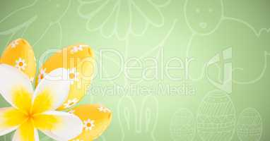 Yellow flower and eggs against green easter pattern