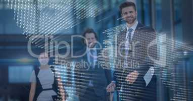 Three business people with blue map graphic overlay