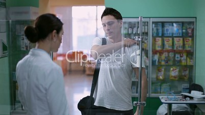Hipster discussing over medicines with pharmacist
