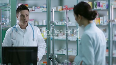 Pharmacist scanning medicines with barcode reader