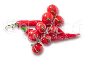 Branch of cherry tomatoes and two red chili peppers
