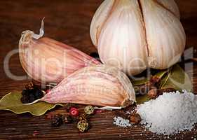 Clove of garlic and spices pile of salt