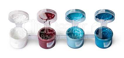 Few colored acrylic paints in open jars