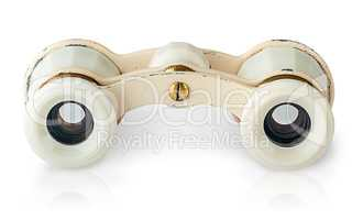 In front old vintage pair of opera glasses horizontally