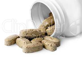 Open plastic bottle and heap of vitamins