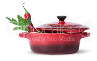 Parsley with red chili pepper in saucepan