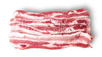 Several pieces of bacon stacked in layers