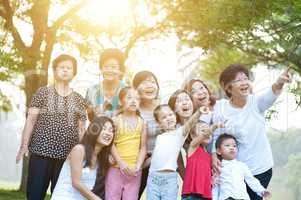 Large group of Asian multi generations family having fun outdoor